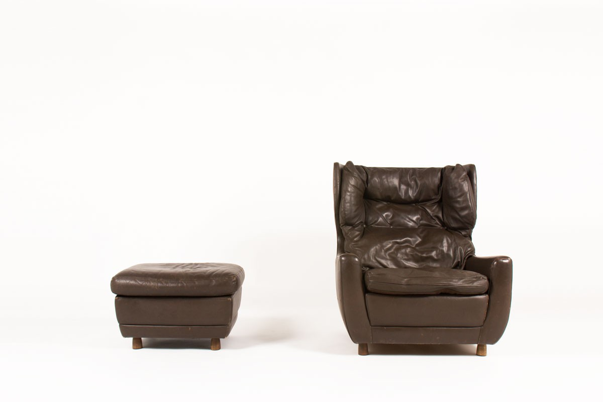 Armchair and footrest in brown leather and wood feet 1970