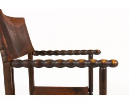 Armchair in dark wood with brown leather 1950
