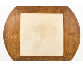 Table basse ronde Charles Dudouyt en chêne et parchemin 1930