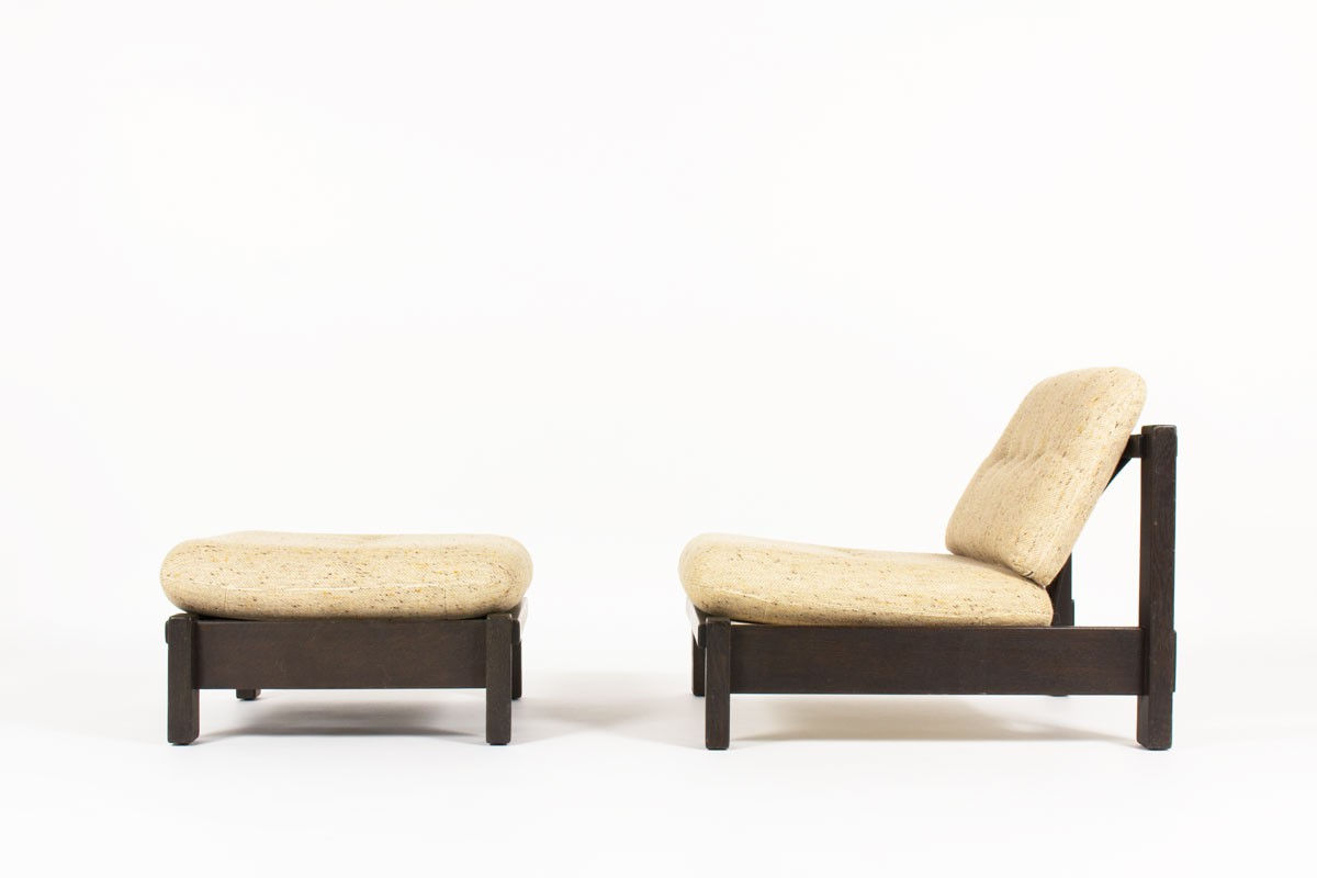 Armchair and footrest in blackened oak and beige fabric 1950