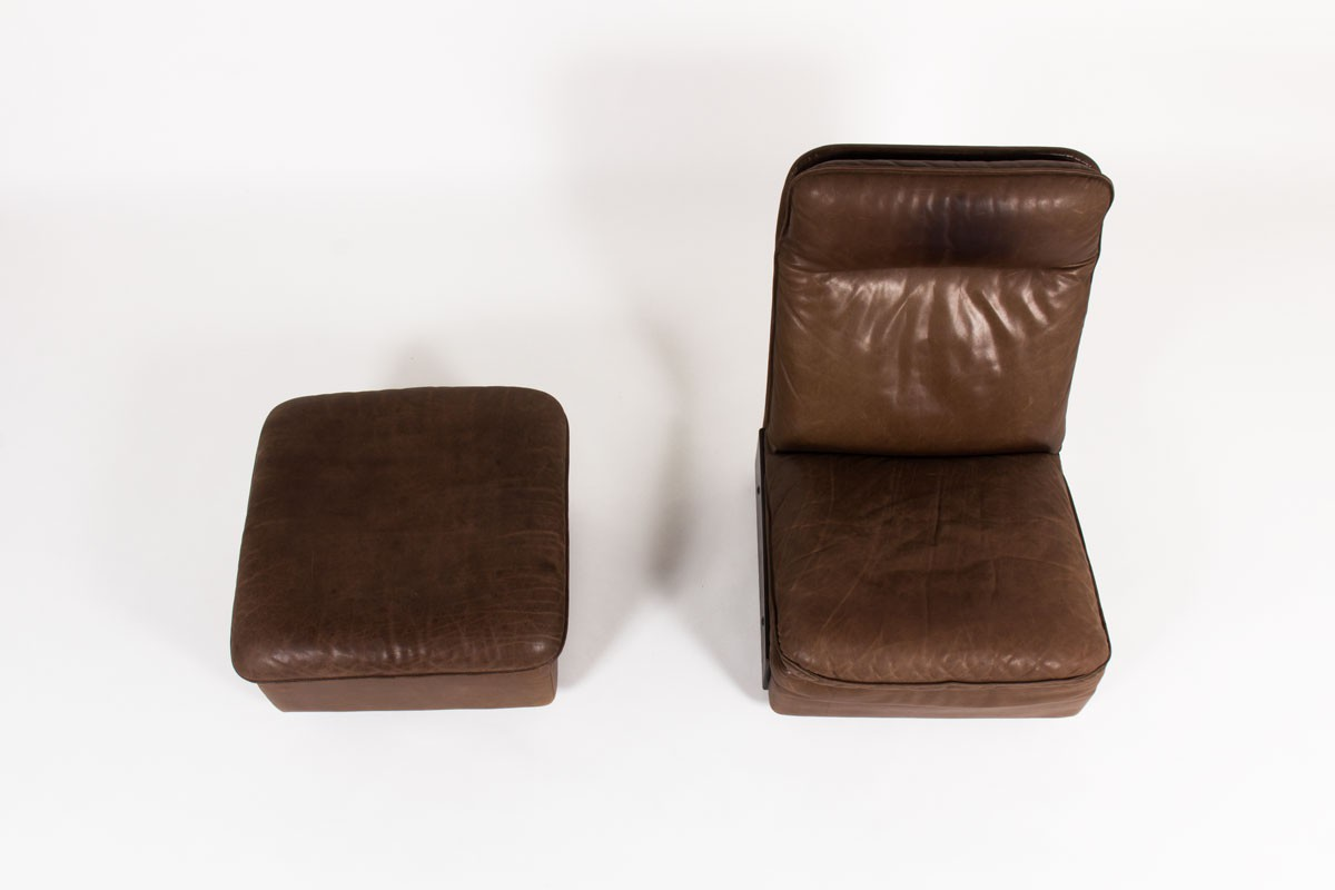Armchair and footrest in leather edition De Sède 1970