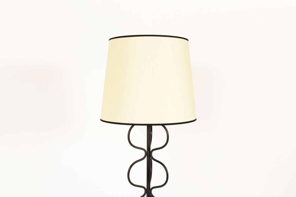 Tripod floor lamp in black metal with beige lampshade 1950