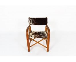 Fauteuil pliant hêtre et assise peau de vache 1950