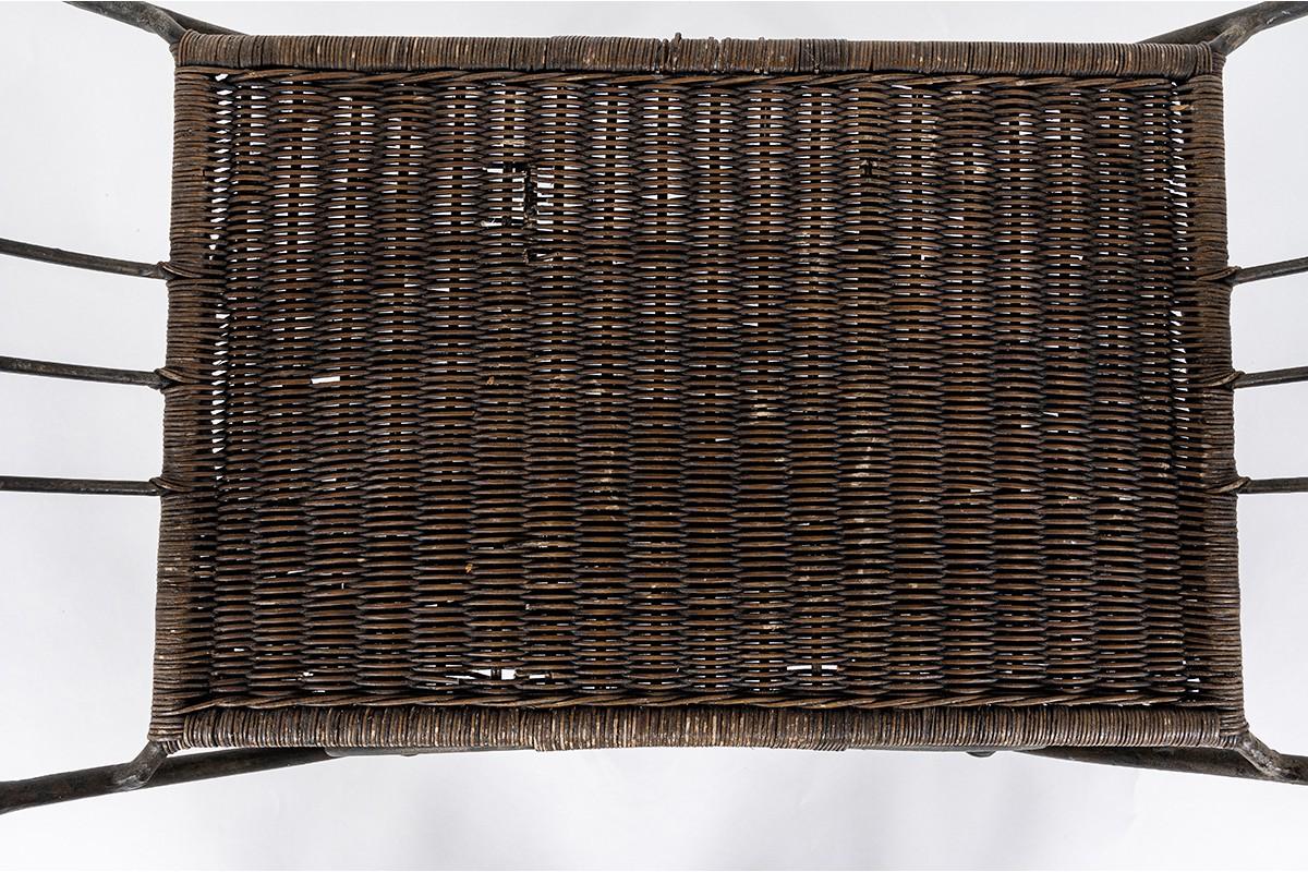 Tabouret en métal patiné et rotin 1930
